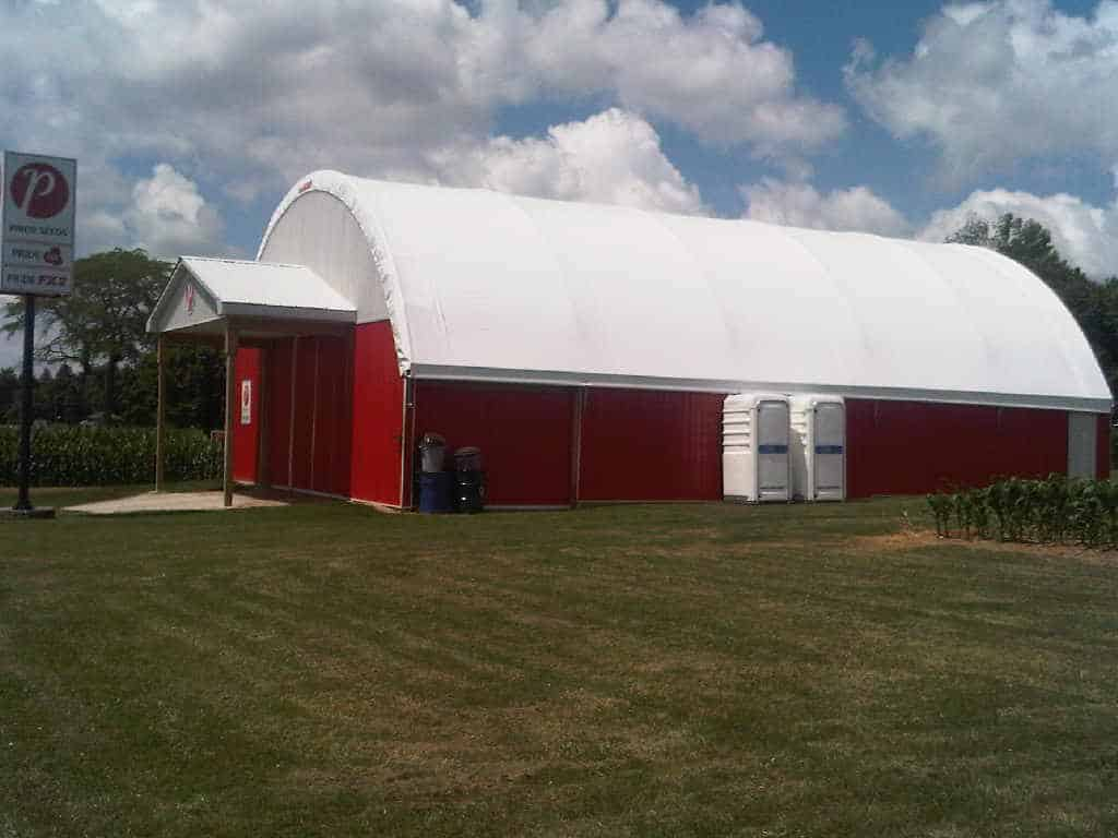 Red barn with 2 white portable units